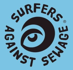 Image of the Surfers against sewage logo (A black wave with an eye in the middle and the words surfers against sewage around it on a blue background)