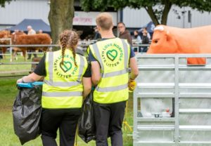 Photo of two people on a litter pick wearing Love Norfolk Hate Litter hi-viz jackets