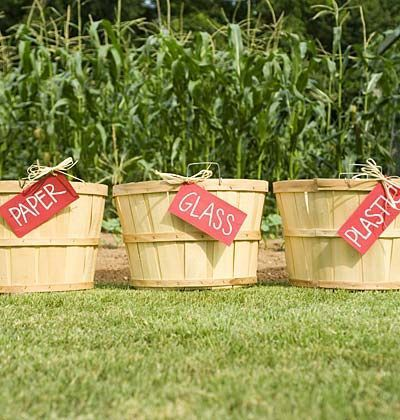 image of alternative recycling bins (wooden buckets with labels)