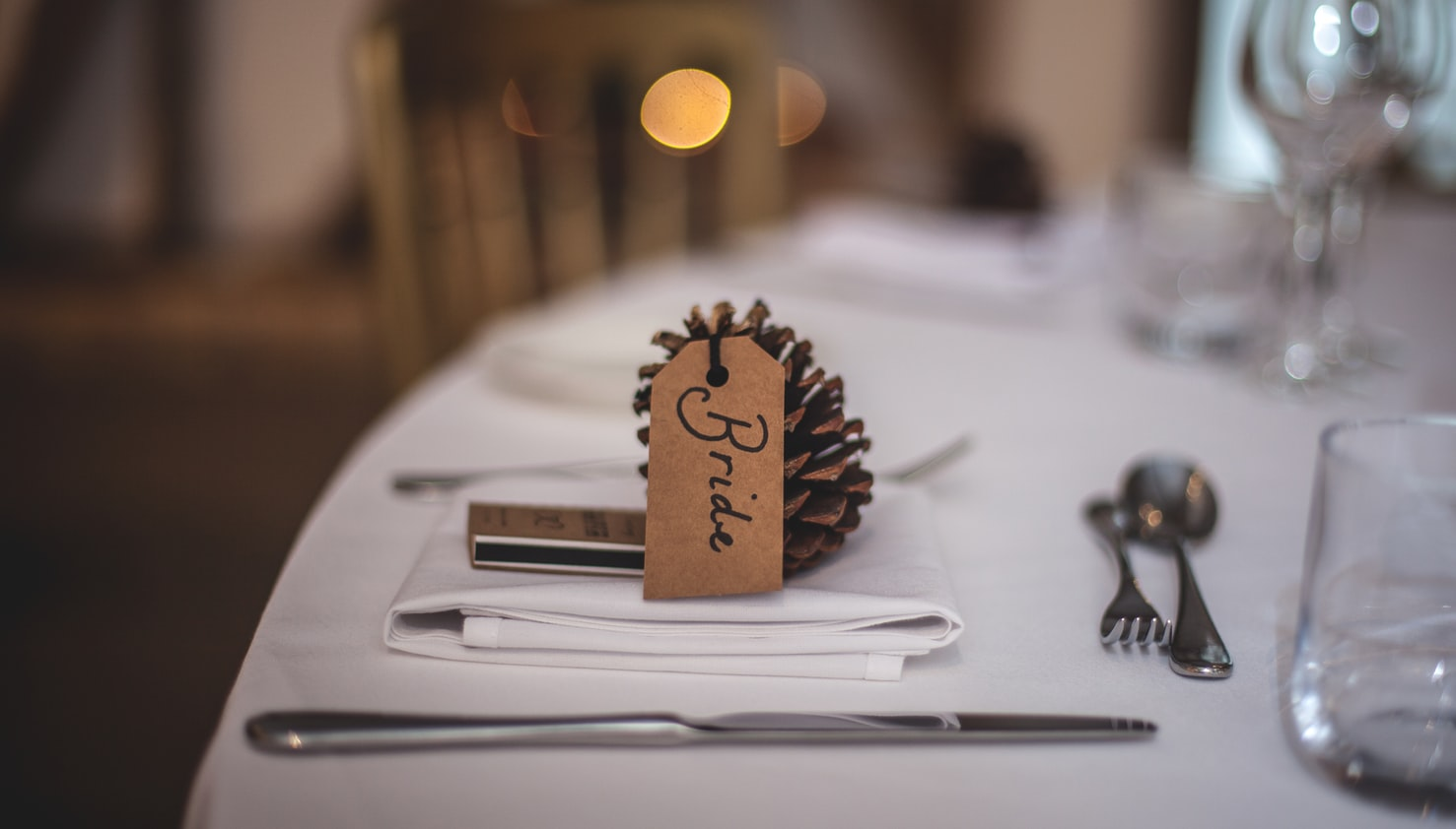 image of a environmentally friendly name place setting. (Pine Cone with name label)