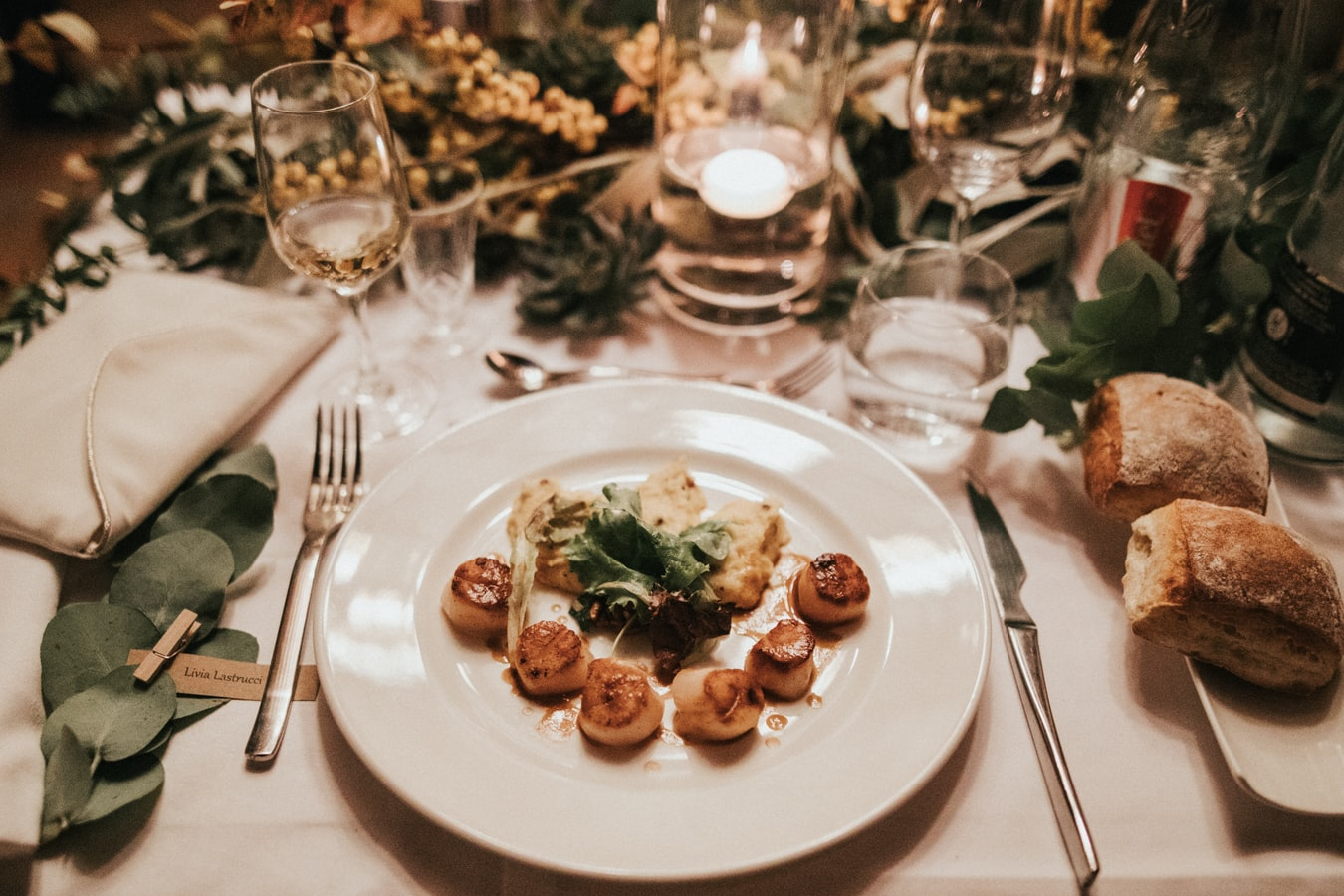 image of a dinner place setting with scallops