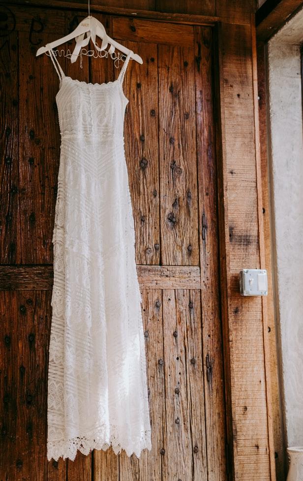 image of wedding dress hanging on door