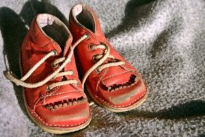 photo of scuffed red children's shoes