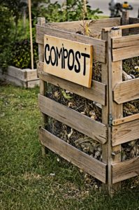 Image showing a homemade compost bin with a wooden 'Compost' sign