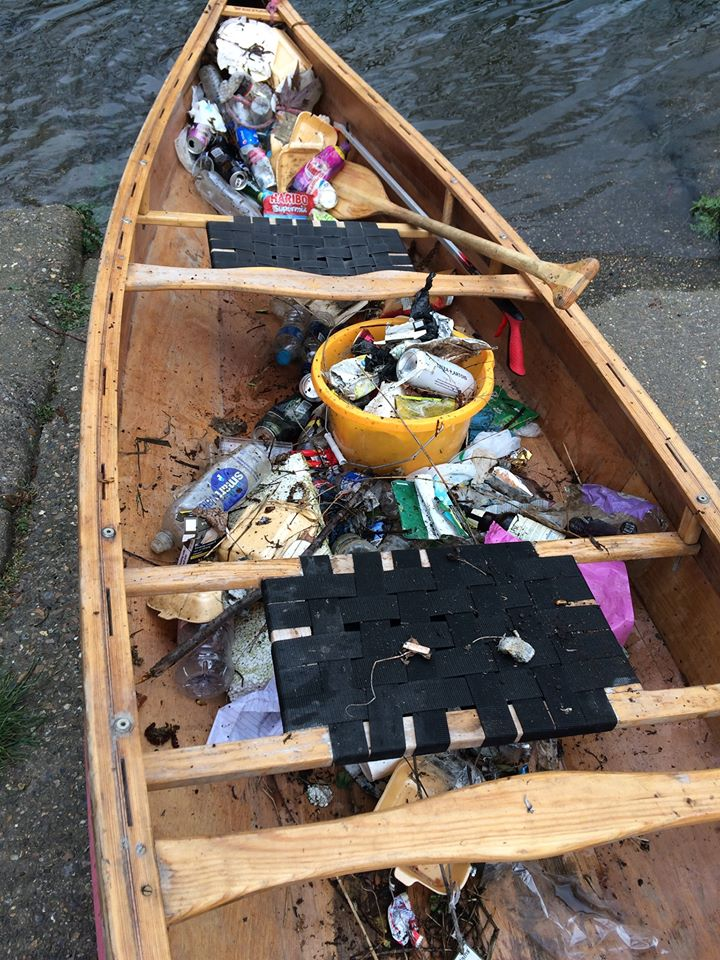 image of a row boat filled with rubbish