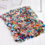 Image of a handmade rag rug, clicking this image will open a pdf instruction guide